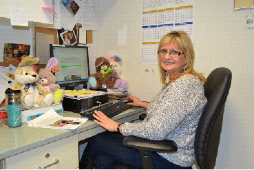 Florence Williams, recreation therapy worker, making plans for Easter
