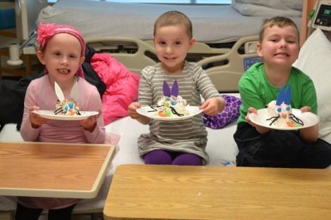 (l-r) Nevaeh , Eva and Kaeden showing off their Easter Bunny Cakes together.