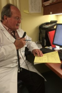 Dr. Eric Stone, Eastern Health cardiologist, using a dictation system to document a patient's electronic medical record.
