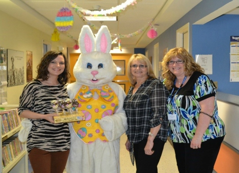 The Easter bunny visits the Janeway! (l-r) Recreation therapy workers Trixie Mahoney, Florence Williams and Lisa Lane posing with the Easter Bunny at the Janeway Children's Health and Rehabilitation Centre