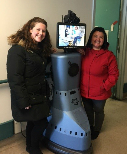 (l-r) Jennifer Shea and Katie Dicker with Rosie the Robot in Nain