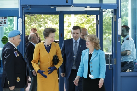 Princess Anne is welcomed to the Caribou Memorial Veterans Pavilion by Eastern Health CEO David Diamond and Vice President Alice Kennedy.
