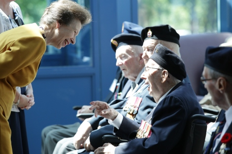96-year-old veteran Gerald Greenslade (far right) tells Princess Anne about the time during WW 2 when he met another princess – her mother Elizabeth.