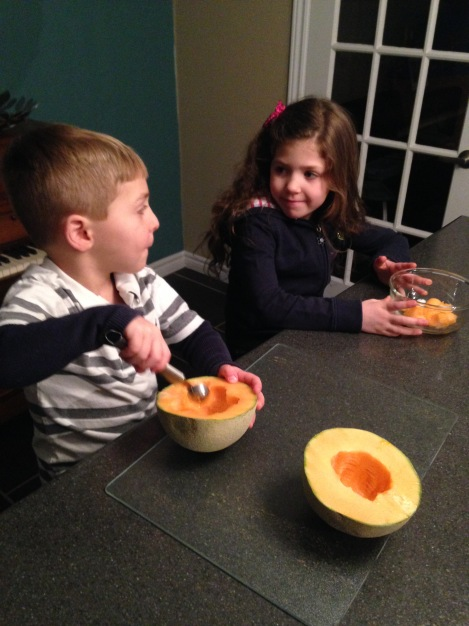 Health Promotion Consultant Ashley Crocker's children preparing and enjoying a melon snack