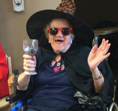 A spirited resident enjoying her unit's Halloween party