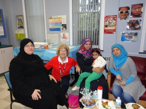 Public Health Nurse Janet Fox Beer (not shown in the photo) meets group of Syrians mothers along with Public Health Nurse Barbara Albrechtsons (second from left).