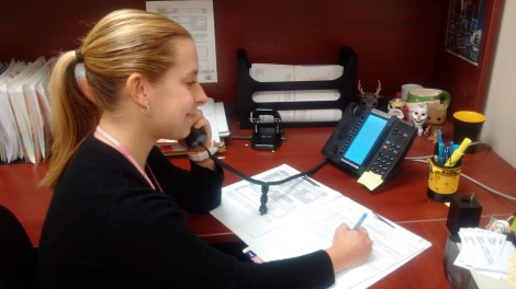 Sara Fernandez, newborn screening coordinator, calling a parent with test results