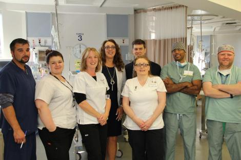 (l-r): George Oakley, RN (CVICU); Shannon Wheeler, RN (MSICU); Janice Escott, RN (CVICU); Sharon Gregory, Division Manager (CVICU and CCU); Carolyn Morey-Shiner, RN (CVICU); Dr. Corey Adams, Cardiovascular Surgeon; Dr. Chuck Yeggapan, Anesthesiologist/Intensivist; Andrew McArthur, Perfusionist