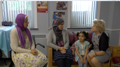 ANC Interpreter Hala Mostafa (left) is a valuable resource for Public Health Nurses and families