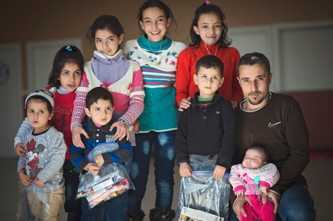 Some of Newfoundland and Labrador's Syrian refugee children, and father of two, Hamed Al Tawiila (right.) Photo courtesy of the Association for New Canadians (ANC)