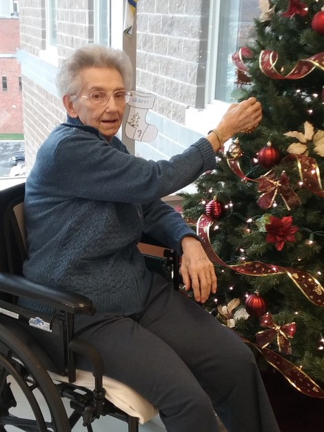Mary Broomfield Decorating her Unit Christmas Tree