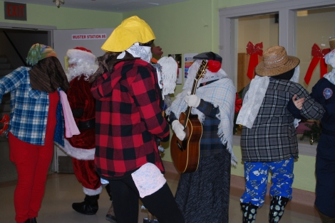 The hospital corridors ring with the sights and sounds of mummering in the days leading to Christmas