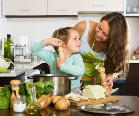 Mother and daughter enjoying cooking at home.