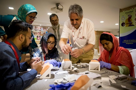 Dr. Atamjit Gill demonstrates suturing technique using 3D models. Photo by Travis C Horn.