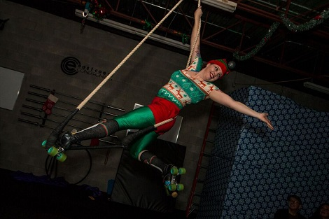 Dr. Sarah Pegrum participating in aerial performance during the holidays last year.