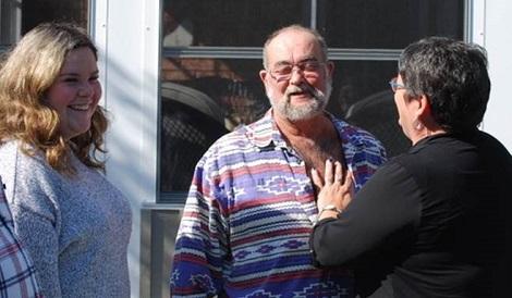 Jeff's sister Jodi looks on as Pat feels Jeff's heart beat in recipient Robert Buttle's chest.