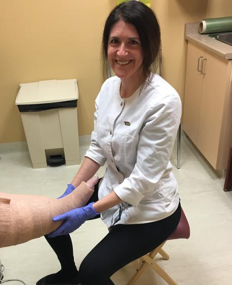 Natasha providing would care during a clinic.