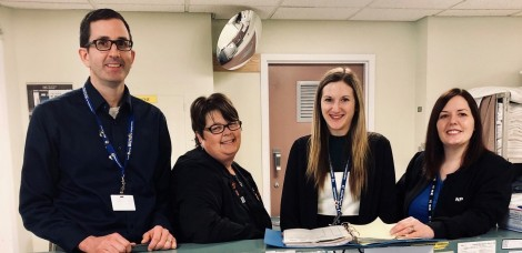 A clinical pharmacist consults with other health providers on the vascular surgery unit at St. Clare's Mercy Hospital. (L-r): Darryl Burke, vascular clinical pharmacist; Lorie Dinn, vascular nurse practitioner; Heather Williams, pharmacist resident; and Kara Ryan, vascular nurse practitioner with Eastern Health