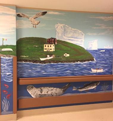 From boats to the Newfoundland Tricolour flag, Christa was determined that her mural would resonate with the residents