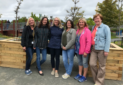 Members of the Therapeutic Recreation team in front of the accessible therapeutic garden bed. (l-r): Patti Carey, Trixie Mahoney, Airdrie Miller, Janice Bugden, Karen Kane, and Marjorie Scott.