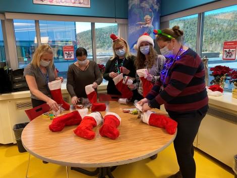 Patti Carey, recreation worker; Janice Bugden, recreation worker; Jane Wells, recreation worker; Trixie Mahoney, recreation worker; and Heather Bishop, recreation specialist; prepare for Santa's visit!